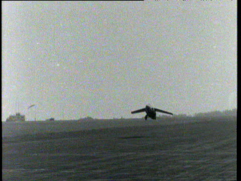 Prototype model of Folland Midge jet fighter taking off from airfield in Hampshire; 28 Aug 54