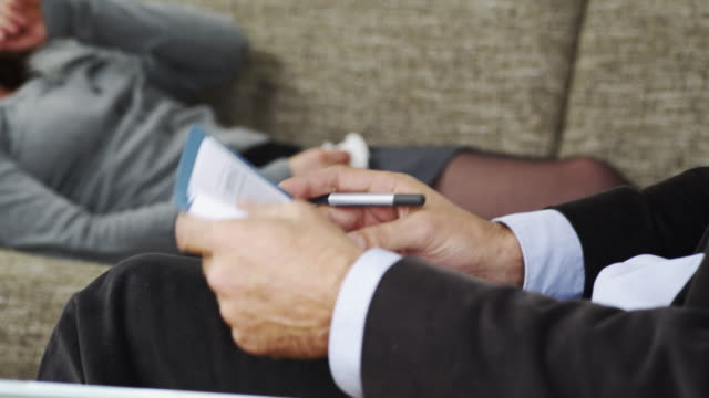 Psychiatrist takes notes