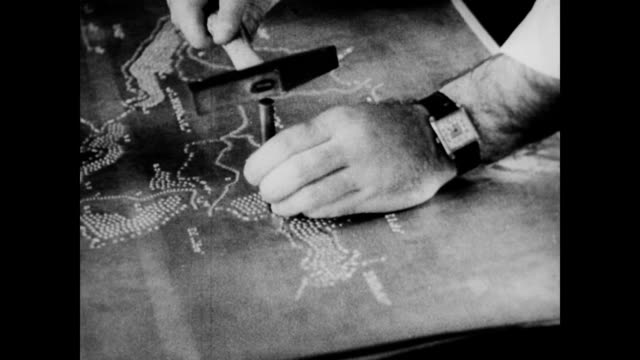 WPA public health projects including nursing and the creation of Braille / Men and women creating brail versions of maps and books / blind people...