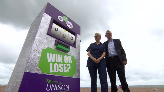 Public sector workers protesting the 1% pay cap at the TUC Congress in Brighton with a 'fruit machine'