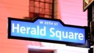 LAPSE Public sidewalk street sign Herald Square 34th Street Midtown Manhattan Broadway New York City USA