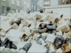 Public Workers' dispute Dustmen's strike a Boing London Berwick Street Market EXT Pan huge pile of rubbish at kerbside NAT