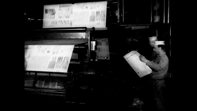 MS Publication building traffic FG INT MS Printing press machine workers MS Reading trade newspaper INT WS Editorial office MS Man typing MS...