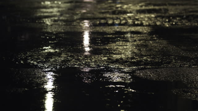 CU TU MS Puddles and traffic on street at night, New York City, New York, USA