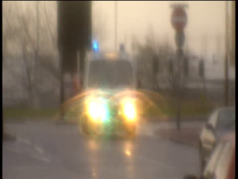 Pull focus blurred image of travelling ambulance