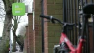 Pull focus entrance to a Job Centre Plus in London UK on Friday Jan 24 A woman pushing a pram enters a Job Centre Plus A middleaged woman walks...
