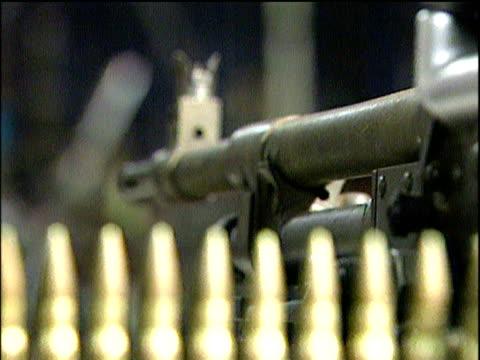 Pull focus from barrel of gun to bullets in gun amnesty Northern Ireland; 2006