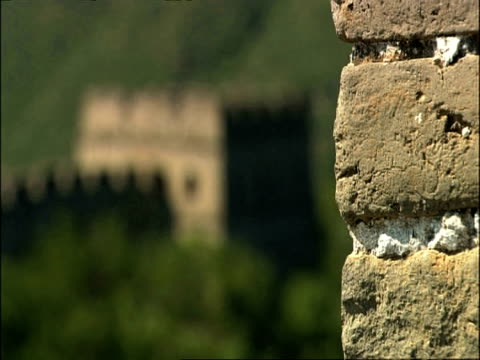 Pull focus from bricks in battlement to watch tower on Great Wall of China, Mutianyu, China