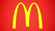 Pull focus into McDonald's golden arches logo Pull focus out of McDonald's golden arches logo A beverage cup and large fries stand in the foreground...