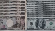 Pull focus Japanese 10000 yen banknotes and US onehundred dollar banknotes laid out in Tokyo Tilt down US onehundred dollar banknotes Pull focus...