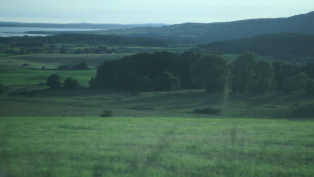 Pull focus on rolling fields and hills.