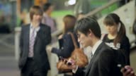 Pull focus shot of men smoking at the train station Scenes Of Shibuya on May 09 2013 in Tokyo Japan