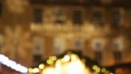 Pull Focus Shot shoppers walk around the various stalls at the Bath Christmas Market on its opening night on November 28 2013 in Bath England...