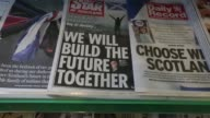 Pull out newspapers in piles on a newsagents shelf featuring headlines on the Scottish independence referendum polling day in Edinburgh UK on...