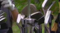 Pulling clubs from bag