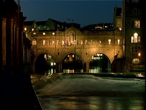 T/L Pulteney Bridge, Bath, River Avon flowing through arches of bridge at dusk