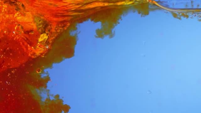 Pumpkin Splashing Color Water (Super Slow Motion) - Stock Video