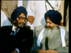 Punjab State demands regional home rule Sant Harcharan Singh Longowal sitting surrounded by armed guards on temple rooftop ZOOM IN Rajiv Gandhi at...