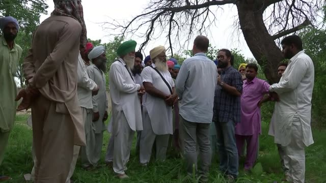 Punjabi farmers hooked on heroin Various shots body being carried along road surrounded by cortege Various shots women along with widow Funeral...