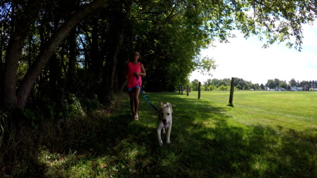 puppy and girl running towards camera