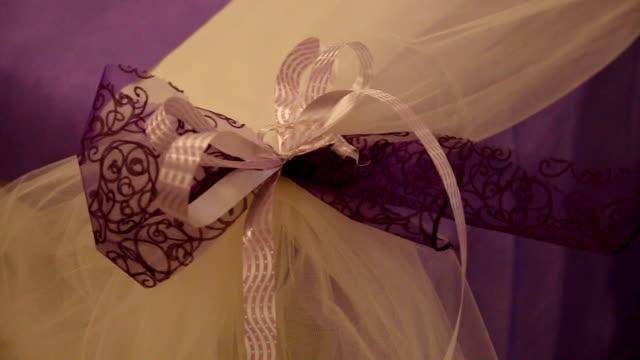 Purple bow with diagonally ribbon