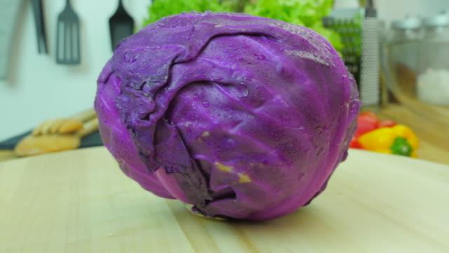 Purple cabbage on wooden turner.