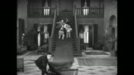 Pursued Buster Keaton pulls rug out from under group of people trying to capture him