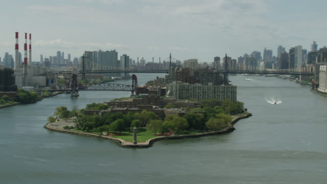 Push in shot of the Roosevelt Island Lighthouse with the Queensboro Bridge in the background