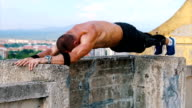 Push ups on the edge of the roof