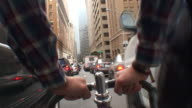 POV push-in - A bicyclist pedals past other traffic in San Francisco. / San Francisco, California, USA