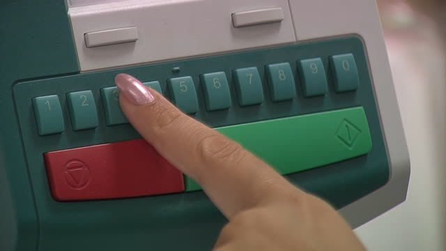 Pushing the buttons on the keypad