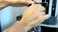 put a plastic film in a tensile machine