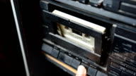 put old cassette in a tape recorder in low ligt