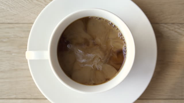 Put the milk in the poured coffee