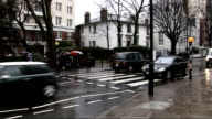 EMI puts Abbey Road studios up for sale EXT / RAIN GVs of people and traffic along by famous zebra crossing / People posing for photographs on zebra...