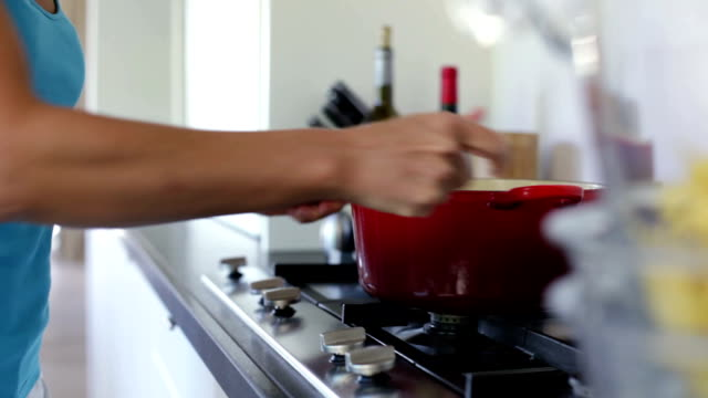 Putting a pan on gas furnace
