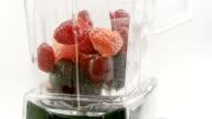 LD Putting fruit into a blender jar