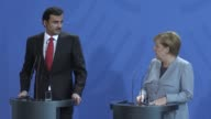 Qatari Emir Sheikh Tamim bin Hamad Al Thani and German Chancellor Angela Merkel hold a joint press conference following their talks at the...