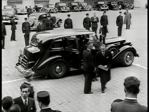 Quai d'Orsay building HA VS Mouvement Rpublicain Populaire leader Georges Bidault exiting car entering building Foreign Ministers meeting INT...