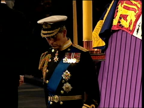 Queen addresses nation/Grandsons join vigil ITNPOOL London Westminster Hall Prince Andrew Viscount Linley Prince Charles and Prince Edward down steps...