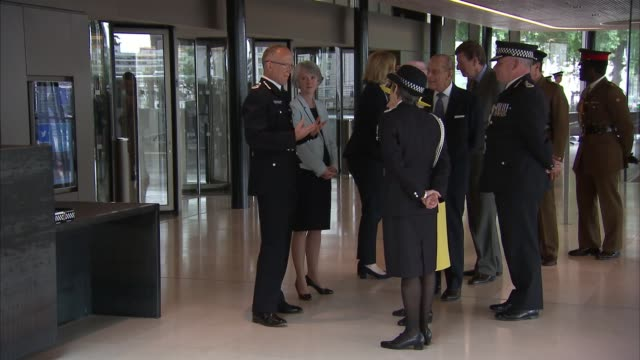 Queen and Duke of Edinburgh visit New Scotland Yard building ENGLAND London Westminster New Scotland Yard INT Book for PC Keith Palmer Flame in...