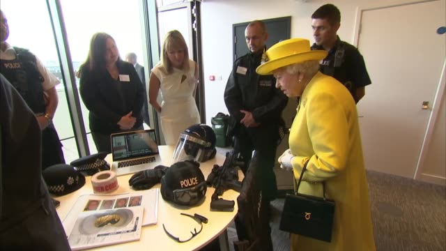 Queen and Duke of Edinburgh visit New Scotland Yard building Queen Elizabeth II and Prince Philip along chatting with police officers / meet police...