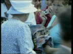Queen and Prince Philip Collection 4 T01030207 Jubilee tour Australia Queensland Queen meeting crowds in rainforest with ranger Aboriginal dancers at...
