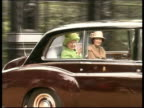 Queen and Prince Philip Collection 4 T06020210 50th anniversary of the Queen's accession to the throne guns fire salute Queen in car at Sandringham...