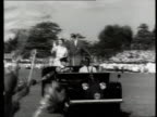 Queen and Prince Philip Collection 7 12256 Nigeria visit Queen Elizabeth II and Prince Philip standing in LandRover waving to crowds