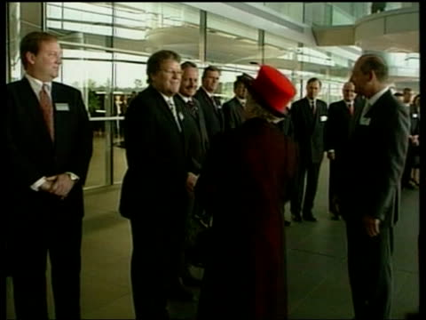 Queen and Prince Philip Collection 8 6875/04 The Queen visits the McLaren Formula One team Woking exterior McLaren HQ Queen Duke of Edinburgh greeted...