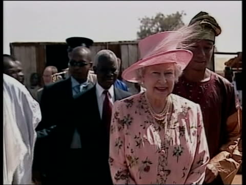 Queen and Prince Philip Collection 8 T04120316 The Queen tours open air market in Nigeria Nr Karu Queen looking at goods on sale
