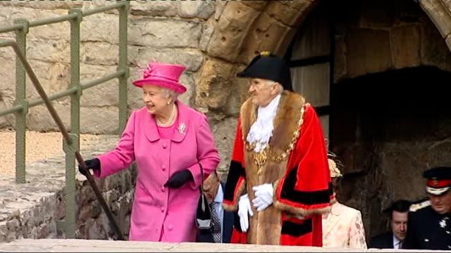 visit to Caernarfon Castle WALES Gwynedd Caernarfon Castle EXT Wide shots inside Caernarfon Castle ruins / Queen Elizabeth II along in castle grounds...