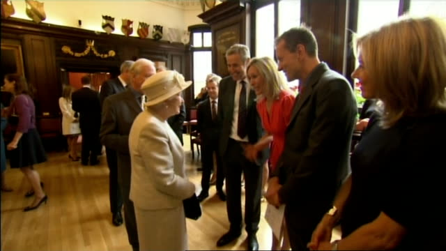 Queen and Prince Philip meeting journalists at charity event ITV News presenters Mark Austin and Mary Nightingale and ITN Editor Geoff Hill meeting...