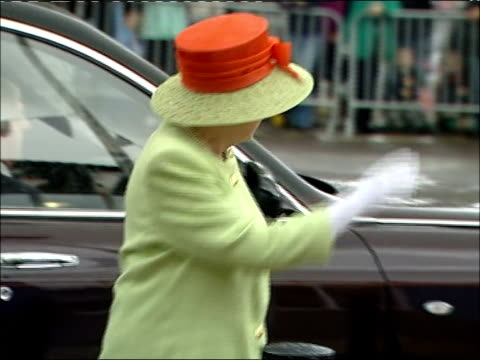 Queen and Prince Philip visit organic dairy products factory Car carrying Queen and Duke of Edinburgh along / Queen from car to cheers and into...